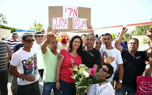 "Likud MK Miri Regev, center, surrounded by supporters last month. The sign reads ""Miri we are with you."" (photo credit: Yehoshua Yosef/Flash90)"