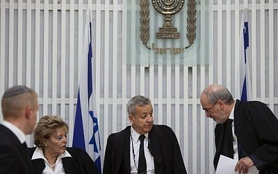 Vice Supreme Court President Eliezer Rivlin (center) flanked by Supreme Court President Asher Grunis (right) and Judge Edna Arbel (left) at a ceremony in honor of Rivlin's retirement from the Supreme Court (photo credit: David Vaaknin/Flash90)