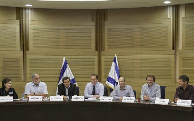 The Knesset's Committee for the Advancement of an Equal Burden, headed by Yohanan Plesner (center) (Photo credit: Miriam Alster/ Flash 90)
