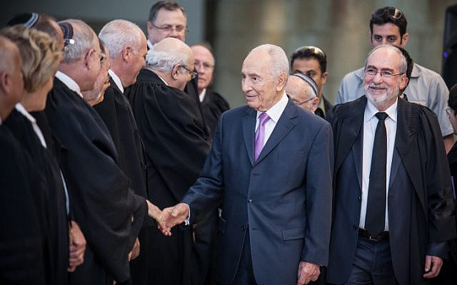 President Shimon Peres greets judges at a swearing-in ceremony of the new Supreme Court justices at the Supreme Court on Thursday (photo credit: Noam Moskowitz/Flash90)