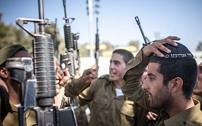 "Ultra-Orthodox soldiers attend a swearing in ceremony as they enter the IDF's ""Nahal Haredi"" unit in June. (photo credit: Noam Moskowitz/Flash90)"