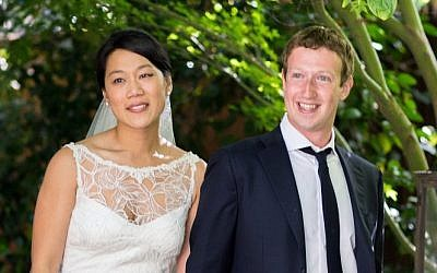 Facebook founder and CEO Mark Zuckerberg and Priscilla Chan at their wedding ceremony in Palo Alto, California on May 19, 2012 (AP/Facebook, Allyson Magda Photography)