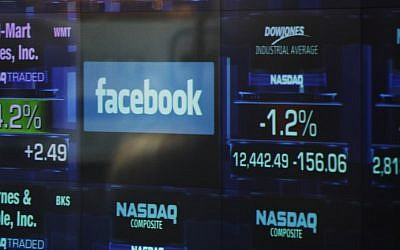 The Facebook logo appears on a display inside the NASDAQ Marketsite in Times Square. (photo credit: AP)