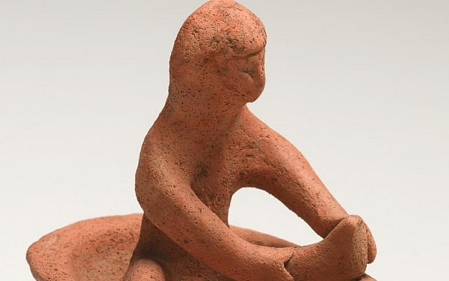 The figurine of the bathing woman was buried in a Phoenician grave in the 8th or 7th century B.C.E. (Photo credit: Courtesy of the Israel Museum)