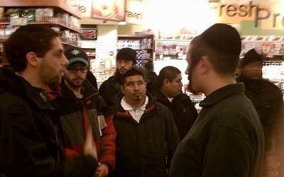 Ari Hart, left, and other Uri L'Tzedek activists protest Flaum's Appetizing with former Flaum employees at Associated Supermarket on the Upper West Side of Manhattan, January 2012. (photo credit: Courtesy Uri L'Tzedek/JTA)