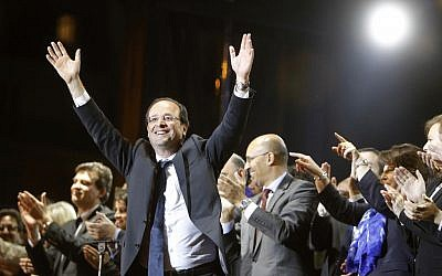 French president-elect Francois Hollande waves to crowds gathered to celebrate his victory in presidential elections in May (photo credit: Laurent Cipriani/AP)