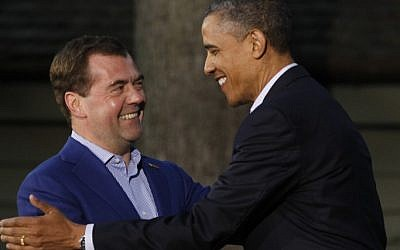 President Barack Obama (right) shakes hands with Russia's Prime Minister Dmitry Medvedev on his arrival for the G8 Summit Friday at Camp David, Md. (photo credit: AP/Charles Dharapak)