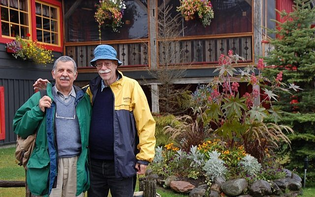 This September 2010 picture provided by the family shows Tim Smulian, a South African citizen, left, and Edwin Blesch, an American, outside the Au Petit Poucet restaurant in Val David, Quebec, Canada. They married in 2007 in South Africa. (photo credit: AP)