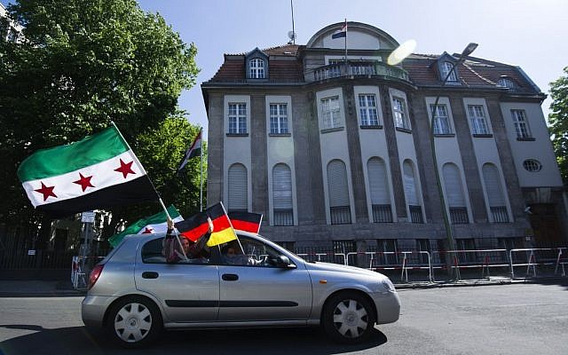 Anti-Assad protesters drive by the Syrian embassy in Berlin, Germany (photo credit: AP Photo/dapd/Clemens Bilan)