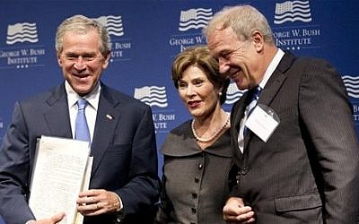 Former President George W. Bush (left), with former first lady Laura Bush, is presented with a collection of writings by former Czech President Vaclav Havel by Martin Palous (right), head of the Vaclav Havel Library Foundation, in Washington on Tuesday. (photo credit: AP/Manuel Balce Ceneta)
