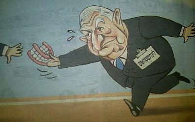 Photo of political cartoon in Maariv, May 15, 2012.