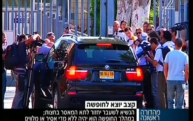 Moshe Katsav leaving prison on Sunday. (Screenshot/Channel 2)