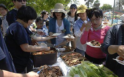 Members of the Korean community in Israel gather in Kfar Menachem (photo credit: JTA/Kangkeun Lee)