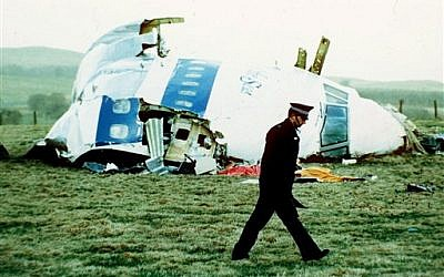 A police officer walks by the nose of Pan Am flight 103 in a field near the town of Lockerbie, Scotland, 1988 (AP/Martin Cleaver)