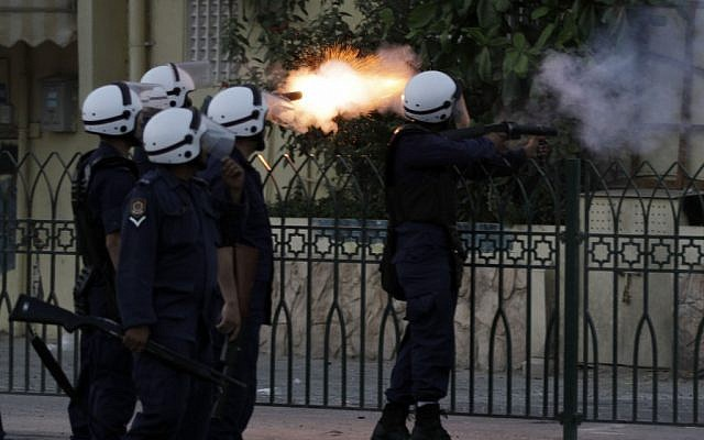 Illustrative: Riot police fire at anti-government protesters in Bahrain (photo credit: AP Photo/Hasan Jamali)