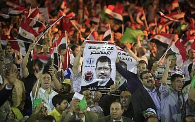 Egyptian supporters of Mohammed Morsi, Muslim Brotherhood's presidential candidate (photo credit: Amr Nabil/AP)