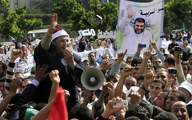 Muslim Brotherhood supporters demonstrate in Cairo (photo credit: AP Photo/Amr Nabil)