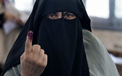 An Egyptian woman shows her inked finger after casting her vote during the first day of the presidential election in a polling station in Alexandria, Egypt, on Wednesday, May 23, 2012 (photo credit: AP/Khalil Hamra)