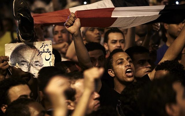 Young Egyptians return to Tahrir Square on Monday night to protest the results of the presidential election. (photo credit: Fredrik Persson/AP)