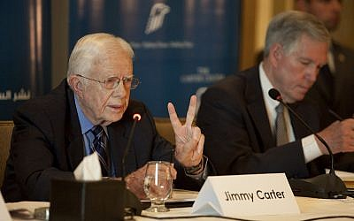 Former US President Jimmy Carter outlines the initial assessments of the Carter Center's election observation mission during a press conference in Cairo, Egypt on Saturday (photo credit: AP/Pete Muller)