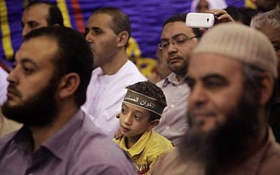 "An Egyptian boy wears a headband in Arabic that reads, ""Muslim Brotherhood"" at a Muslim Brotherhood electoral rally in Cairo (photo credit:AP/Nasser Nasser)"