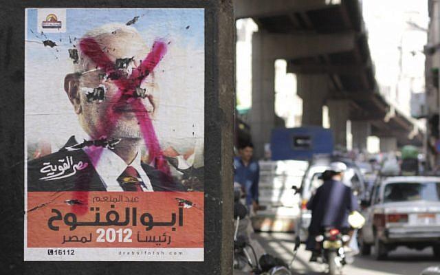 A defaced poster of independent candidate Abd Al-Munim Abu-Fattouh in Cairo (photo credit: AP Photo/Hasan Jamali)