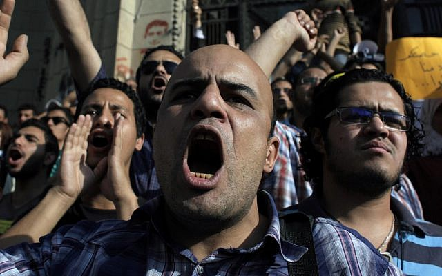 Egyptian protesters chant anti-military slogans in Cairo Sunday (photo credit: AP/Nasser Nasser)