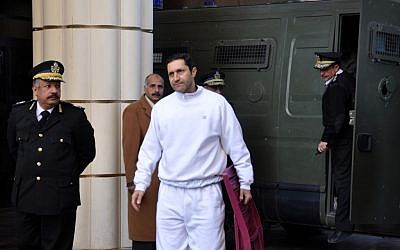 In this Jan. 24, 2012 file photo, Alaa Mubarak, center, son of former Egyptian president Hosni Mubarak arrives at the court house in Cairo, Egypt. Mubarak and his two sons are already in prison and on trial on charges of corruption. (photo credit: AP/Mohammed al-Law)