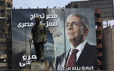 "An election poster of presidential candidate Amr Moussa. It reads, ""Egypt's reconstruction needs the effort of all Egyptians,"" in Cairo, Egypt, last week. (photo credit: Nasser Nasser/AP)"