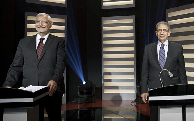 Moderate Islamist Abdel-Moneim Abolfotoh, left, and former foreign minister Amr Moussa stand at their podiums on Egypt's first televised presidential debate in Cairo, MAy 11 (photo credit: AP/Mahmoud Khaled, Al Masry Al Youm)