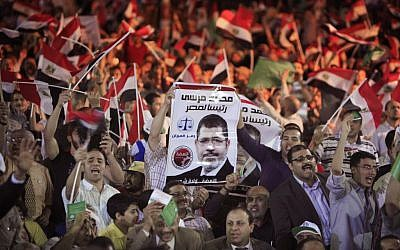 Supporters of Mohammed Morsi, the Muslim Brotherhood's presidential candidate, during an April 30 campaign conference in Cairo (photo credit: AP/Amr Nabil)