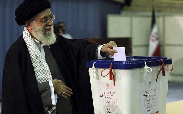 Iranian supreme leader Ayatollah Ali Khamenei,casts his ballot for the parliamentary runoff elections, in Tehran, last May (photo credit: AP/Office of the Iranian Supreme Leader)