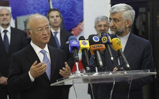 International Atomic Energy Agency (IAEA) chief Yukiya Amano, left, talks with reporters during a news briefing at the conclusion of his meeting with Iran's top nuclear negotiator, Saeed Jalili, right, in Tehran, on Monday (photo credit: AP/IRNA,Adel Pazzyar)