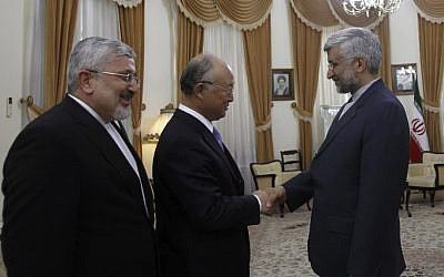 IAEA chief Yukiya Amano, center, meets with Iran's top nuclear negotiator Saeed Jalili, right, and Iran's chief delegate to the IAEA, Ali Asghar Soltanieh, in Tehran last May (photo credit: AP/IRNA/Adel Pazzyar)