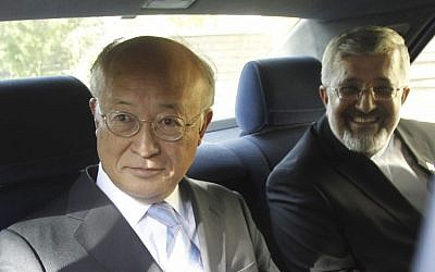 International Atomic Energy Agency (IAEA) chief Yukiya Amano, left, seen leaving his meeting with Iran's top nuclear negotiator, Saeed Jalili on Monday. (photo credit: Adel Pazzyar/IRNA/AP)