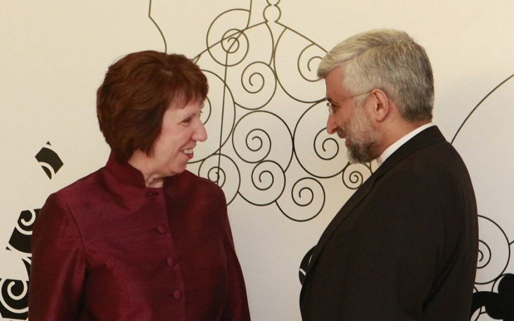 EU Foreign Policy chief Catherine Ashton, left, speaks with Iran's former chief nuclear negotiator Saeed Jalili during May 2012 talks in Baghdad (photo credit: Hadi Mizban/AP)