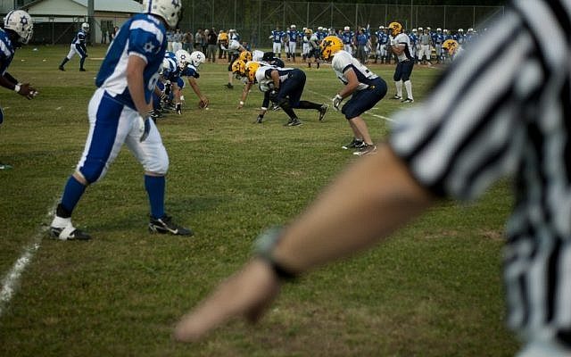 Israel's national American football team plays against NCAA Division III team Maranatha Baptist Bible College at the Baptist Village sport complex near Petah Tikva in 2012. (Ariel Schalit/AP)