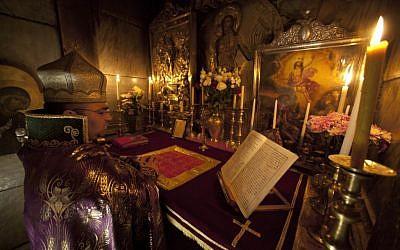 In a centuries-old tradition, clerics from the three largest denominations in the church, the Greek Orthodox, Armenians and Roman Catholics, gather each night for special prayers reserved for the men who take care of the site where Christians believe Jesus was crucified, buried and resurrected. (AP Photo/Dusan Vranic)