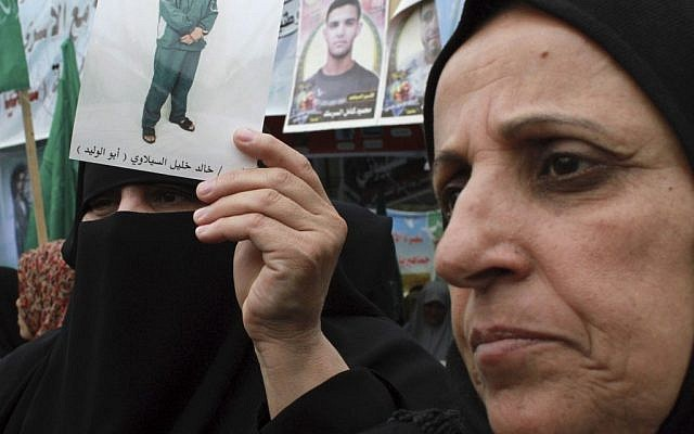 Palestinian women protest in solidarity with hunger strikers (photo credit: AP photo/Hatem Moussa)