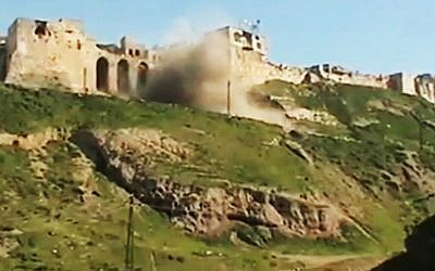 A screen capture of a castle being shelled in Hama, Syria, in March 2012 (photo credit: AP/Ugarit News)