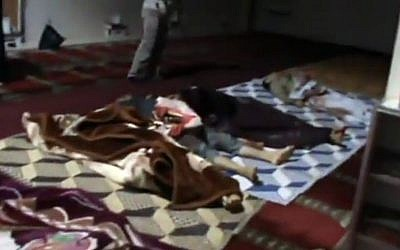 Image capture from video claiming to show bodies of victims killed in Houla massacre on Friday. (AP Photo/Shaam News Network via AP video)