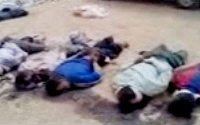 This image made from amateur video released by the Shaam News Network and accessed Tuesday purports to show 13 blindfolded and handcuffed bodies on the ground in Deir el-Zour, Syria. (photo credit: Shaam News Network/AP)