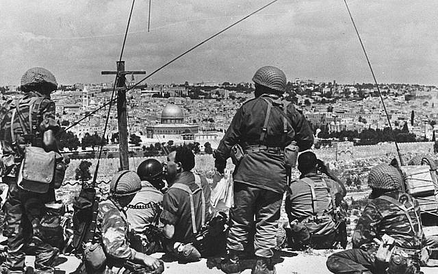 Mordechai Gur (seated, with black curly hair) and his troops survey the Old City before launching their attack, May 1967. (photo credit: Wikimedia Commons CC BY-SA/Mazel123)