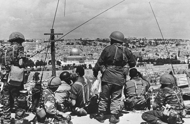 Mordechai Gur (seated, with black curly hair) and his troops survey the Old City before launching their attack, May, 1967. (photo credit: Wikimedia Commons BY-CC-SA/Mazel123)