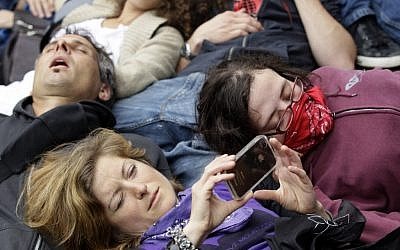 "Protesters in Chicago on Monday take part in a ""die-in"" on the final day of the NATO summit. (photo credit: Nam Y. Huh/AP)"