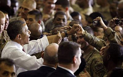 US President Barack Obama meets American troops at Bagram Air Field, Afghanistan, last May (photo credit: AP/Charles Dharapak)
