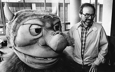 """Maurice Sendak posing in 1985 with one of the characters from his book """"Where the Wild Things Are,""""(photo credit AP)"""