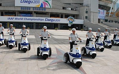 Cops in Seoul, South Korea, on patrol with T3 Motion vehicles (photo credit: Courtesy)