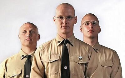 In this 2009 photo, National Socialist Movement members from left, Bret Murphy, Andrew Patterson, Eric Harlan pose for a photo in Medford, Oregon. (Photo credit: AP Photo/The Medford Mail Tribune, Jamie Lusch)