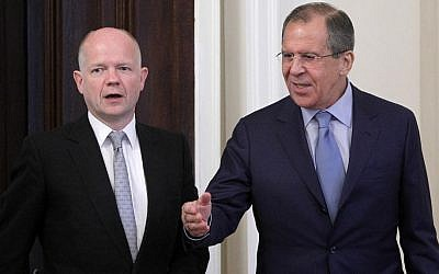 Russian Foreign Minister Sergey Lavrov (right) welcomes his British counterpart William Hague during their meeting on the Syrian crisis in Moscow on Monday (photo credit: AP/Misha Japaridze)
